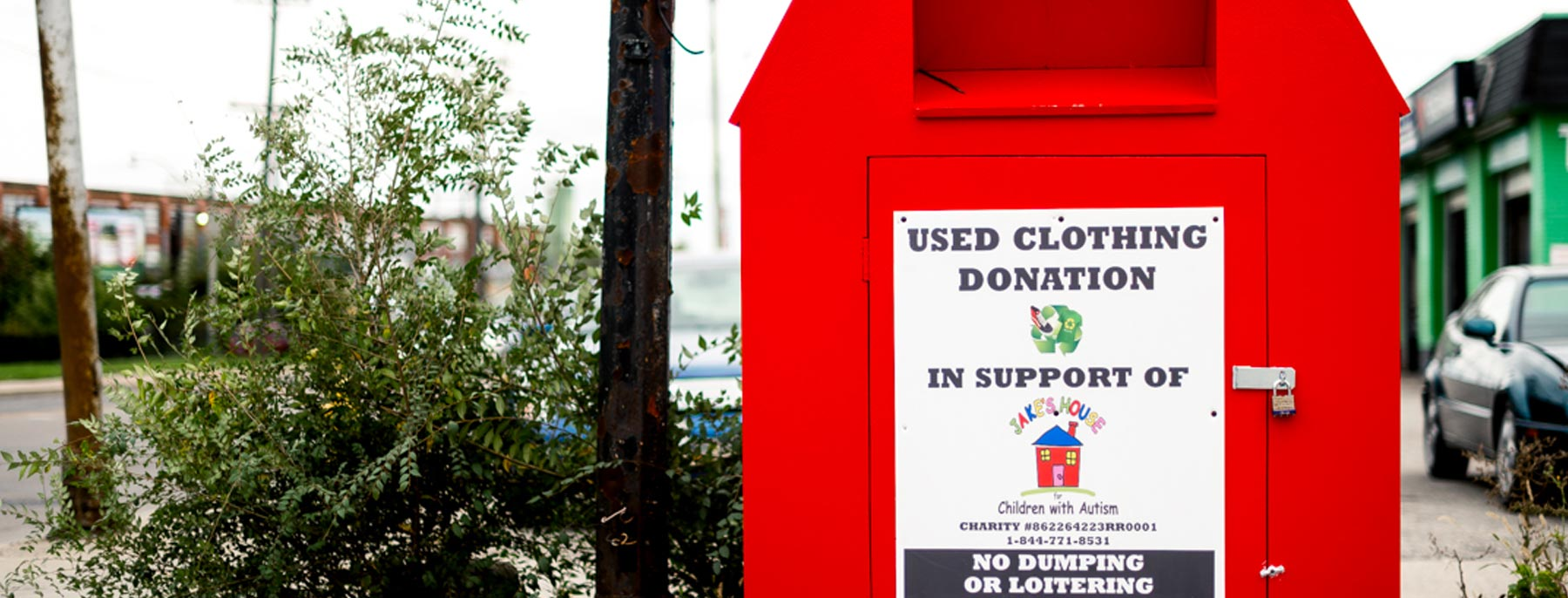 big, red clothing donation bin outside