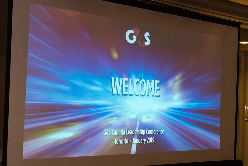 a projector screen showing a welcome slide