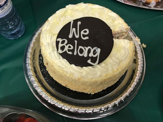 "a cake with the words ""we belong"" written on it in icing"