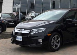 Honda Odyssey parked in front of dealership