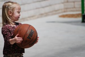 autism volunteer opportunity girl playing basketball